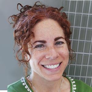 Smiling face of graphic designer Lauren Wohl Sanchez